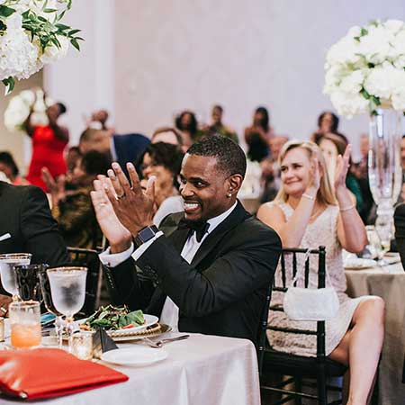 Groom and wedding guests clapping